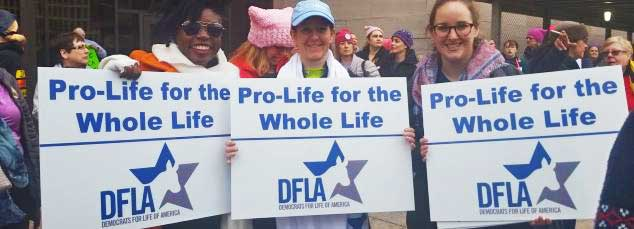 Democrats for Life marchers with signs at Women's March